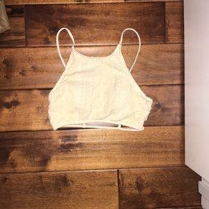 Cream colored high neck bikini top
